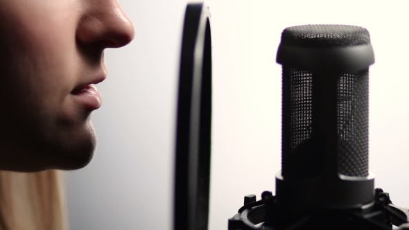 Thumbnail for Woman Profile Singing Into Studio Microphone