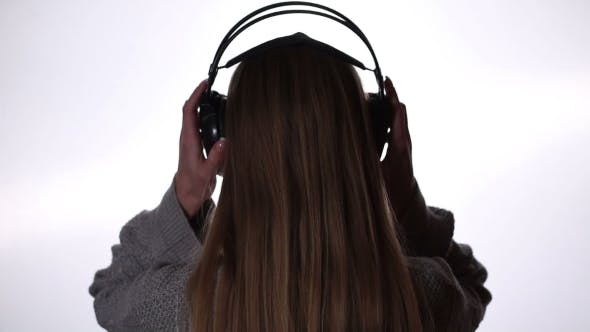 Cover Image for Young Woman Relaxing With Music In Headphones