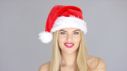 Thumbnail for Adorable Beautiful Girl Posing Isolated In Santa Claus Hat