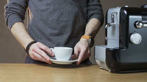Thumbnail for A Man Puts a Cup Into The Coffee Machine