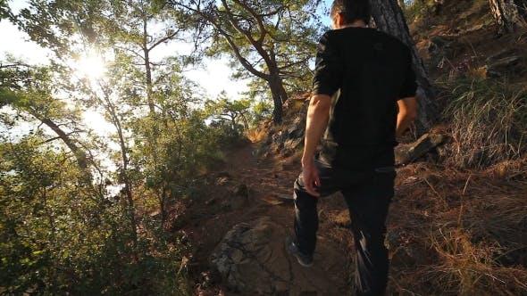 A Male Walking Uphill