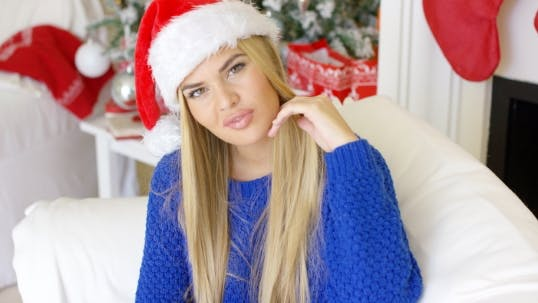 Thumbnail for Cute Young Woman With Santa Claus Hat