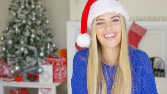 Thumbnail for Beautiful Young Woman In Santa Claus Hat