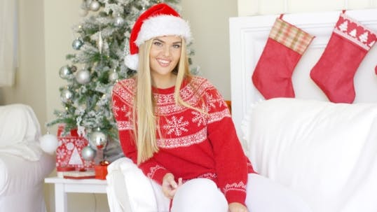 Thumbnail for Beautiful Girl In Santa Claus Hat In Her Living Room