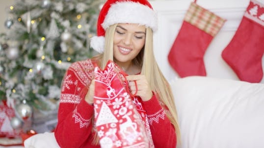 Thumbnail for Pretty Smiling Blondie Looking Inside Her Christmas Gift