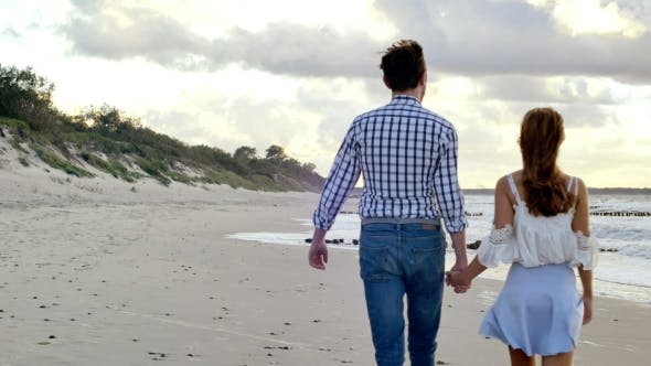 Thumbnail for Walking Couple On The Beach