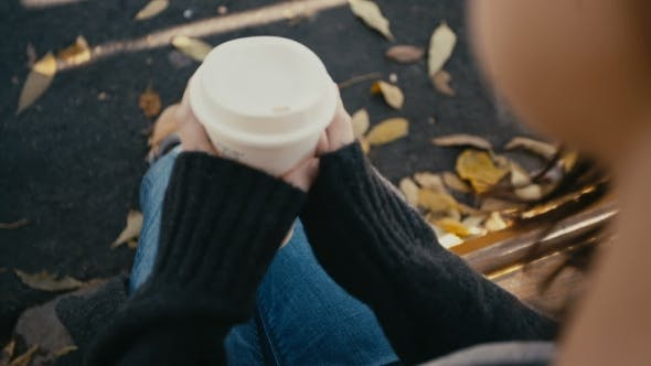 Thumbnail for Young Woman Drinking Hot Coffee In The Autumn Park
