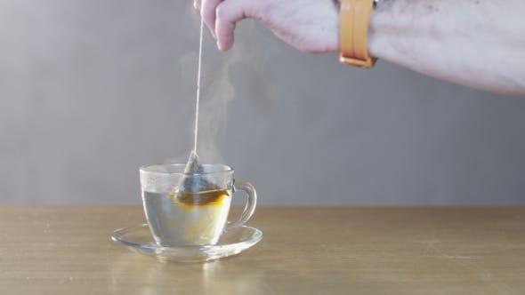 Thumbnail for Man Preparing Tea In a Glass