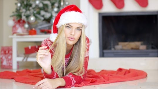 Thumbnail for Adorable Girl In Christmas Outfit Lying On The Floor