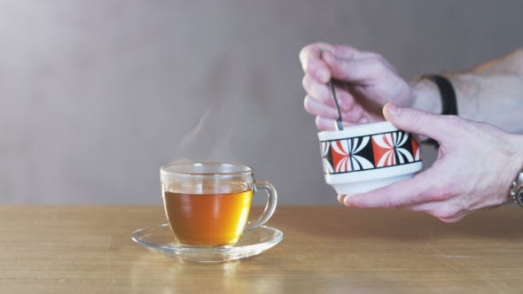 Thumbnail for Man Putting Sugar Into a Cup