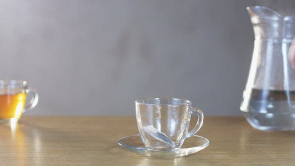 Thumbnail for Man Pours Boiling Water Into a Cup