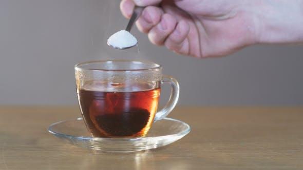 Thumbnail for Man Puts Sugar Into a Cup