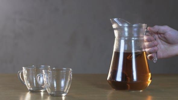 Thumbnail for Man Pours Tea Into a Cup