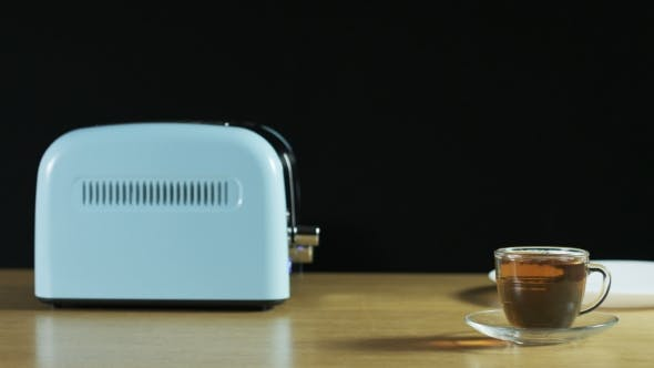 Thumbnail for Man Takes Loaves Of Bread Out Of An Electric Toaster