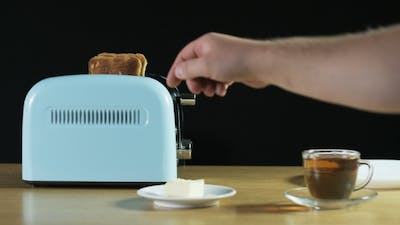 Man Turns The Toaster On