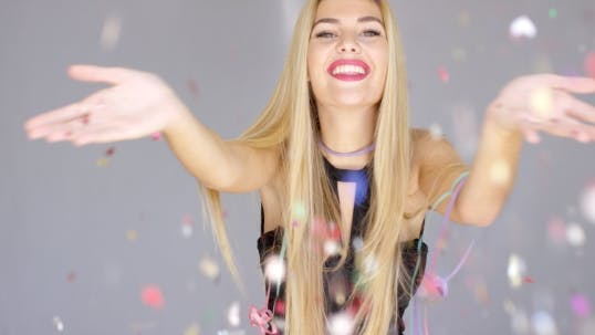 Thumbnail for Sexy, Blond Girl Blowing Confetti To Camera Direction