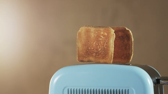 Thumbnail for Two Loaves Of Bread Jumping Out Of An Electric Toaster