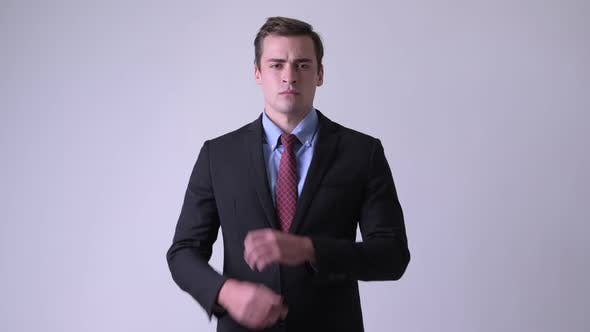 Thumbnail for Young Handsome Businessman Wearing Suit with Arms Crossed