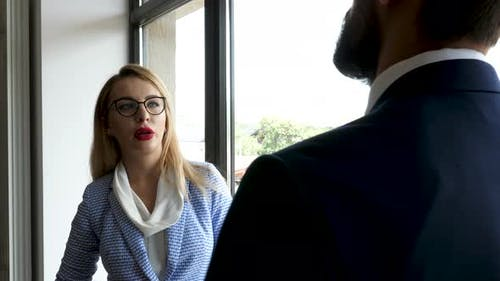 Successful Hard Working Businesswoman Is Talking with Her Colleague