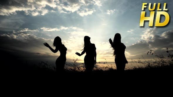 Thumbnail for Silhouettes Against Sunset Of Three Young Slender