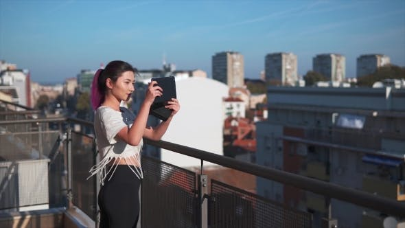 Thumbnail for Girl Using A Smartphone On A Balcony