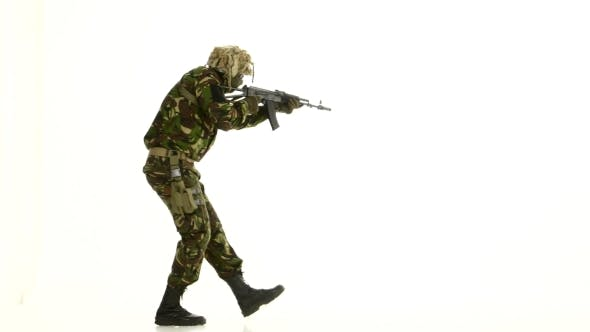 Thumbnail for Soldier In Camouflage Clothing And Armed. White Background