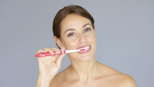Thumbnail for Healthy Young Woman Cleaning Her Teeth