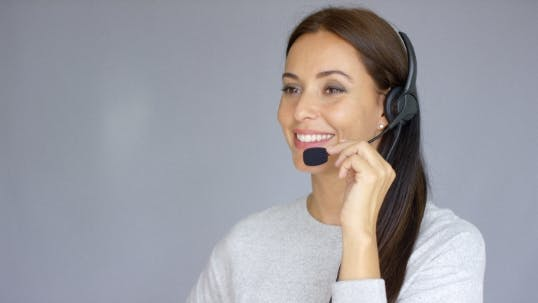 Thumbnail for Beautiful And Positive Female Call Center Agent At Work