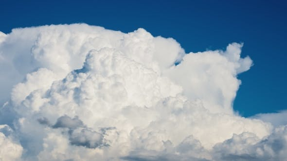 Dramatic Cumulonimbus Clouds Forming On Hot Summer Day With Blue Sky