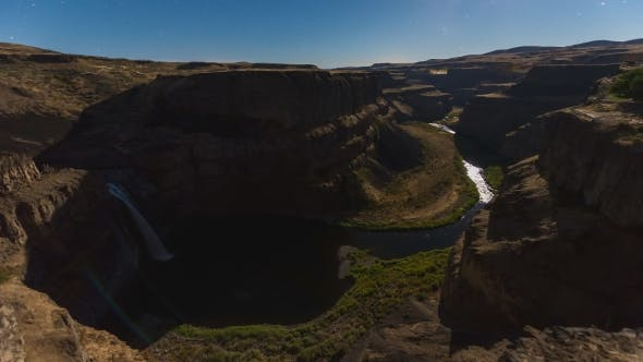 Thumbnail for Shadow Form Moon Illuminating Palouse Falls