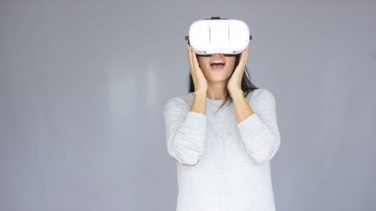 Thumbnail for Excited Woman Watching Something On Her Virtual Reality Helmet