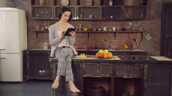 Thumbnail for Female With Modern Device Spends Morning In Flat