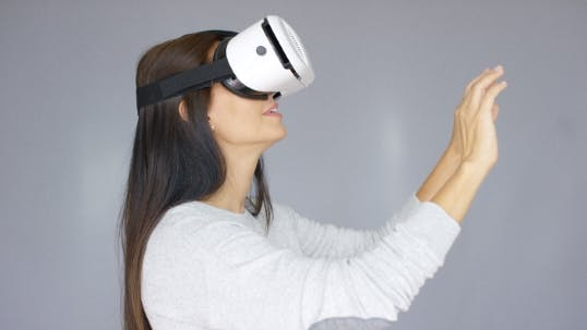 Thumbnail for Adorable Woman Working With Virtual Reality Glasses