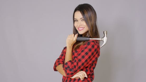 Thumbnail for Beautiful Girl In Checkered Shirt With Hammer