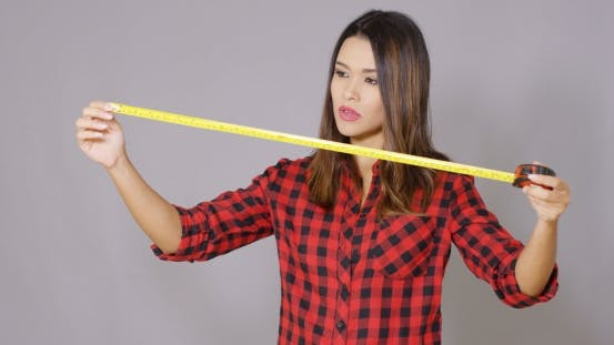 Thumbnail for Beautiful Female Construction Worker Using Measure Tape