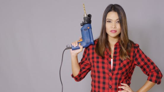 Thumbnail for Capable Attractive Young Woman Holding a Drill