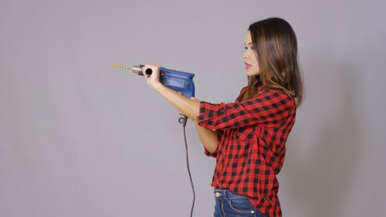 Cover Image for Capable Attractive Young Woman Holding a Drill