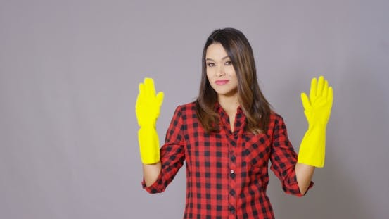 Thumbnail for Attractive Housewife Holding Up Gloved Hands
