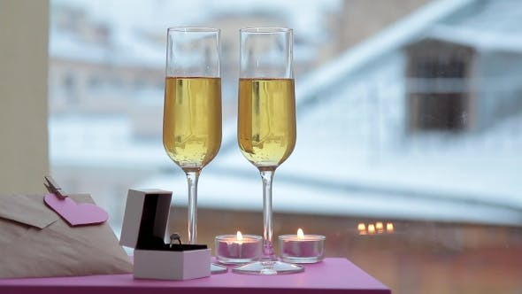Thumbnail for Two Glasses Of Champagne, Ring In Box And Note With Heart In Winter