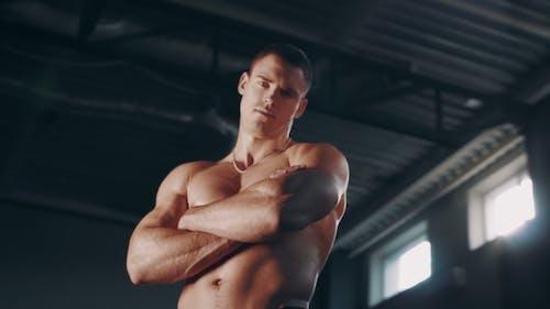Muscular Man Posing Topless