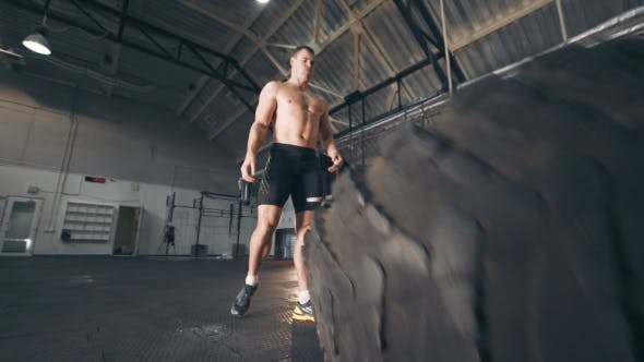Fit Muscular Man Doing Crossfit Exercises