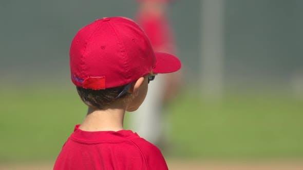 Kids playing little league baseball.
