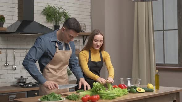 Happy couple enjoying cooking time together at home