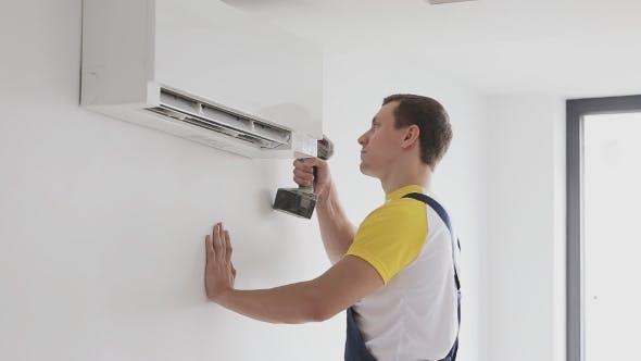 Thumbnail for Repairman Fixing Air Conditioning Indoor