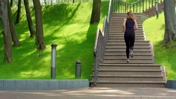 Thumbnail for Fitness Girl Running Up Stairs In . Female Runner Jogging Up Stairs