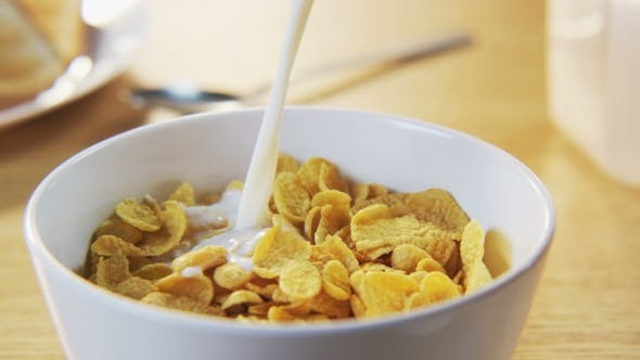Thumbnail for Pouring Milk Into a Bowl With Corn Flakes