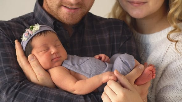Thumbnail for Happy Family Holds Newborn Daughter.