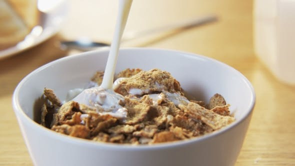 Thumbnail for Pouring Milk Into a Bowl With Muesli