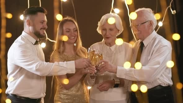 Cover Image for Portrait of Party Guests Clinking Glasses