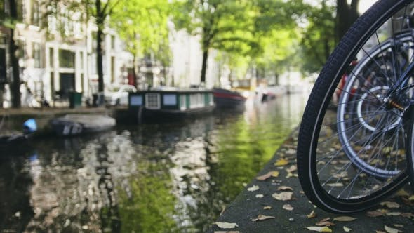 Thumbnail for View Of Wheel Of Bicycle On The Amsterdam Canal, Sunny Day